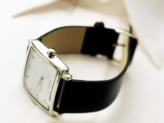 Men's Watch and Shirt --- Image by © Radius Images/Corbis